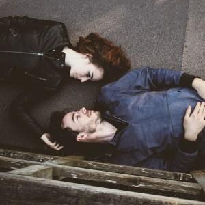 Couple laying on pavement