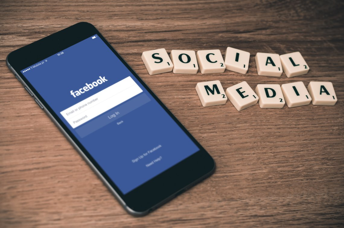 """Facebook app on the iPhone and scrabble letters that spell out """"social media"""""""