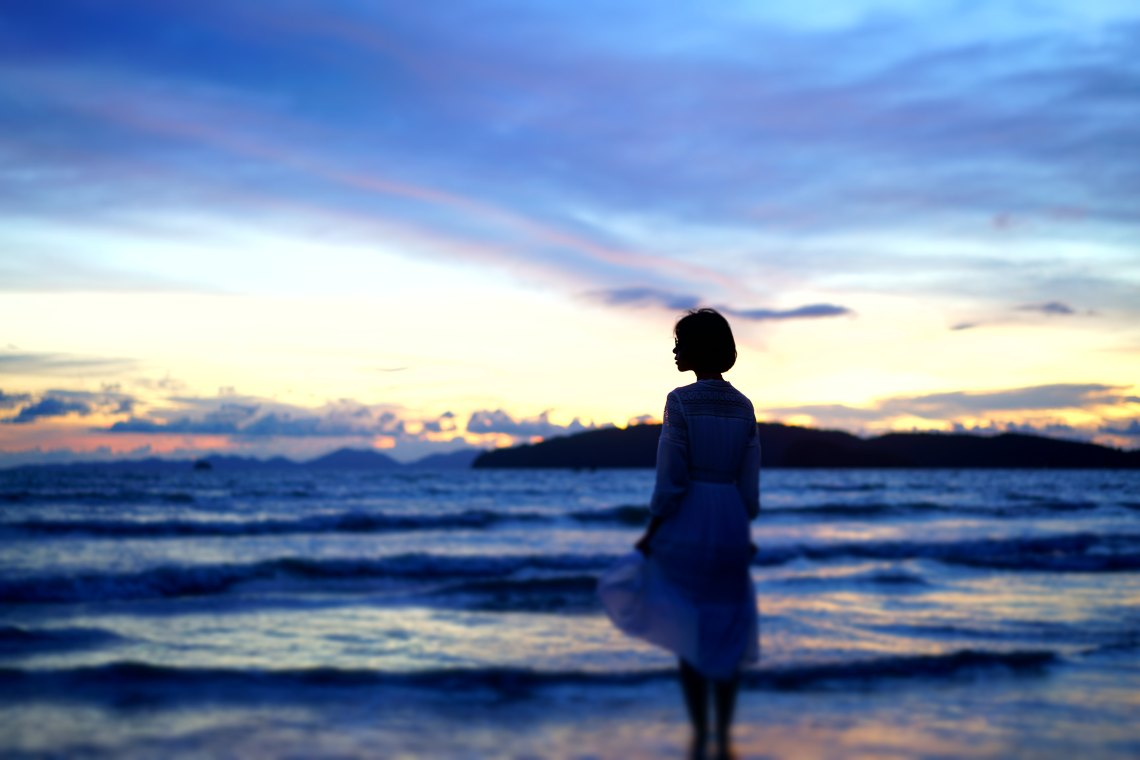 girl standing on the beach, girl at sunset, living unapologetically