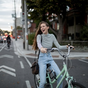 happy girl riding bike in the city