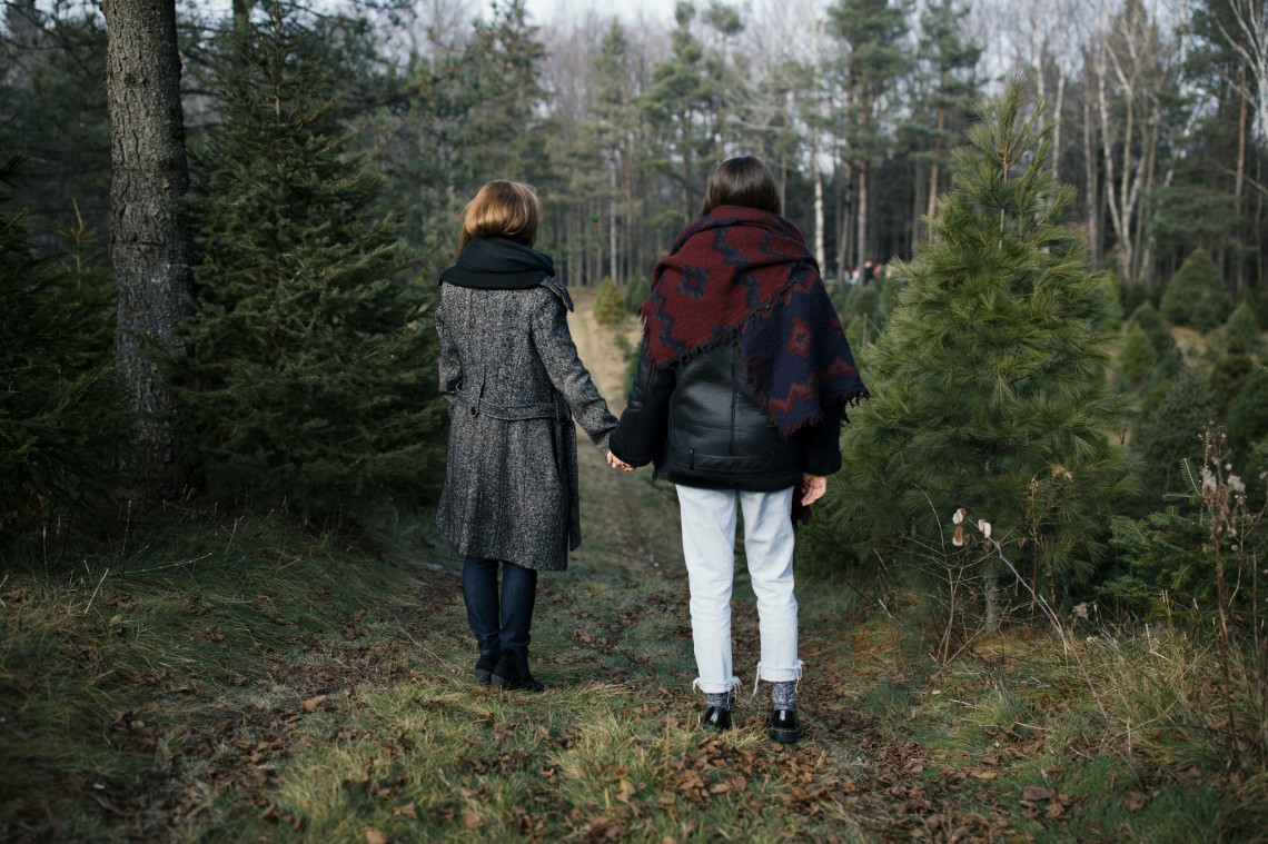 Two Best Friends Taking In The Peaceful Atmosphere while holding hands