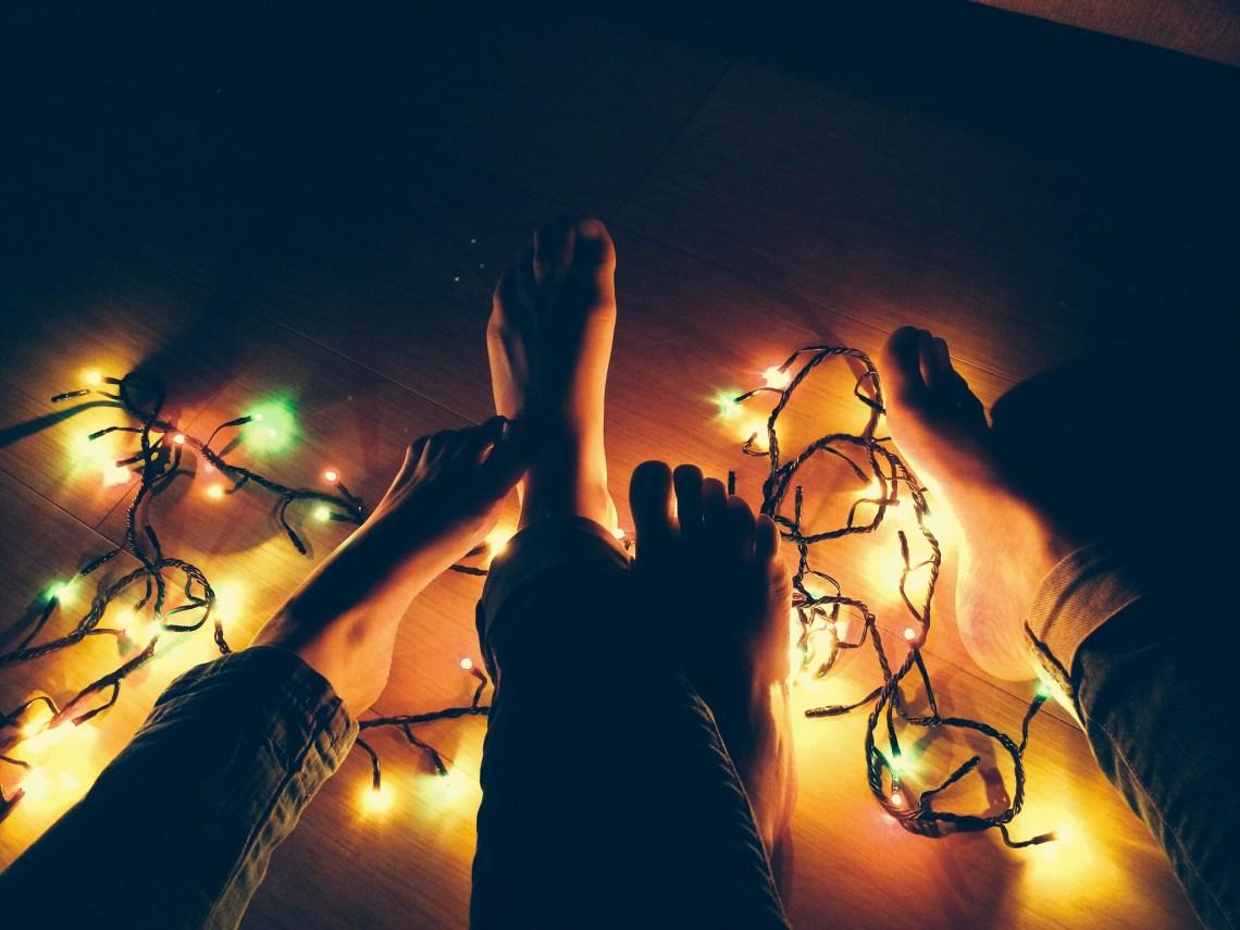 christmas lights and couple feet and legs