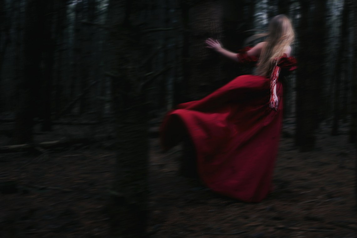 Blood red blurry female fleeing in gown
