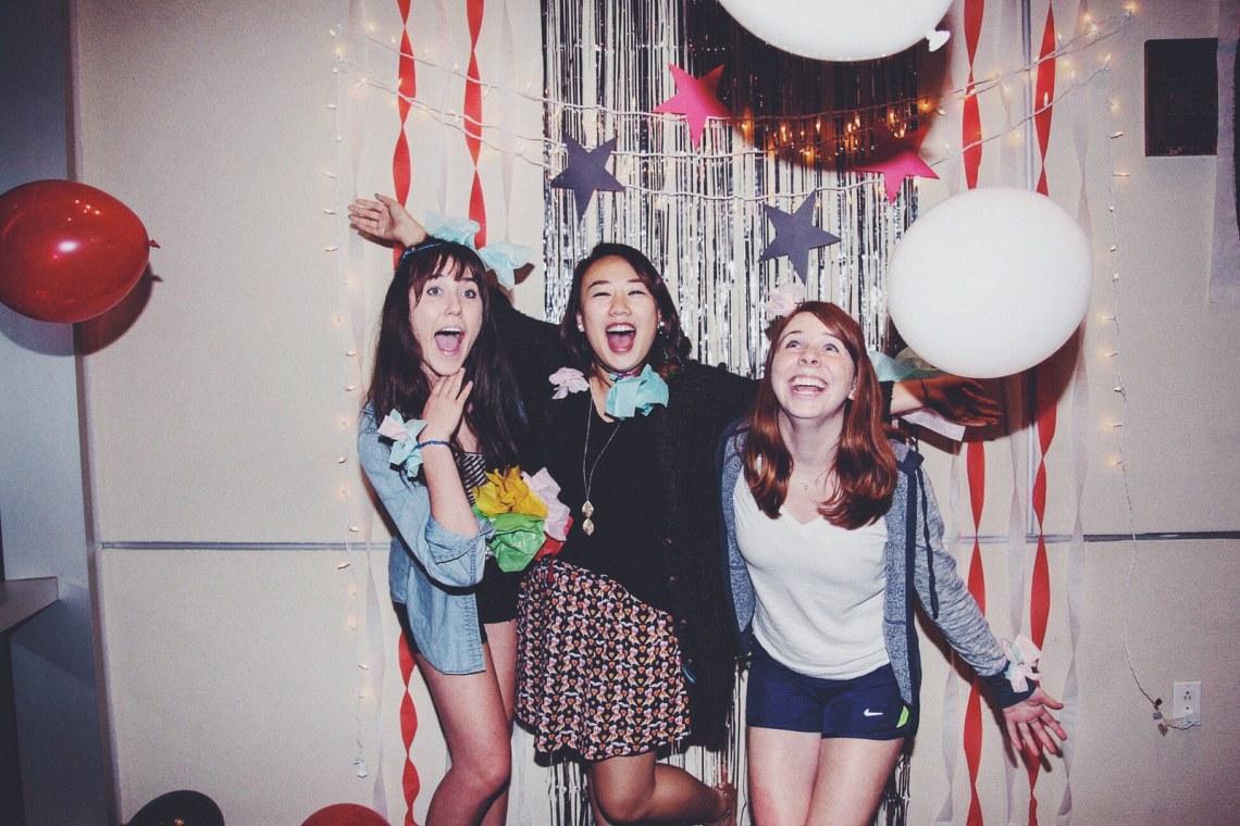 girls best friends party having fun smile laugh balloons celebration