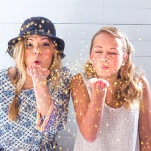 girls blowing glitter