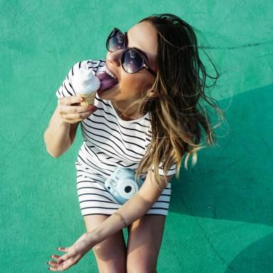 portrait girl poloroid eating ice cream on green wall summertime summer dress