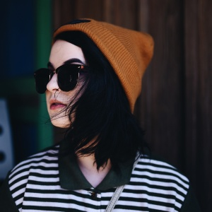 fashionable girl with sunglasses and beanie on