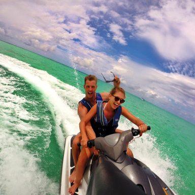 couple riding on jetski having fun