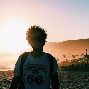 guy in route 66 arizona t-shirt in the summer sunset on the beach