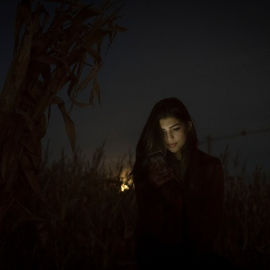 girl standing in the dark backlit by the moon