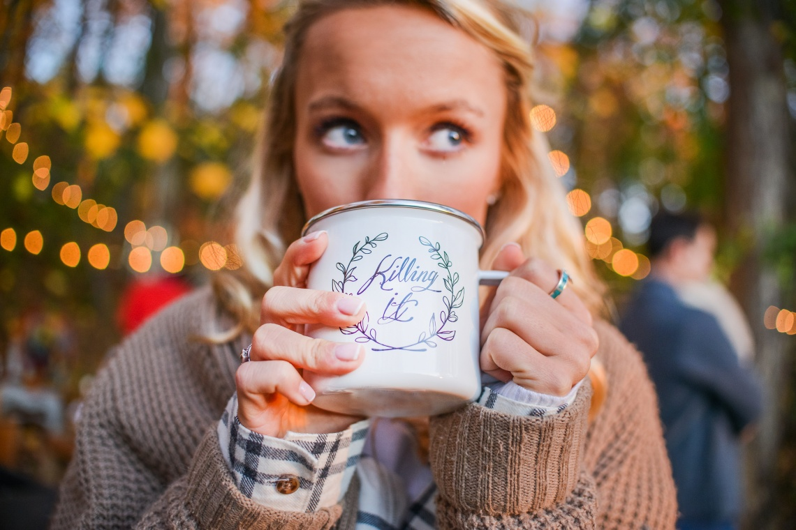 girl drinking out of killing it mug