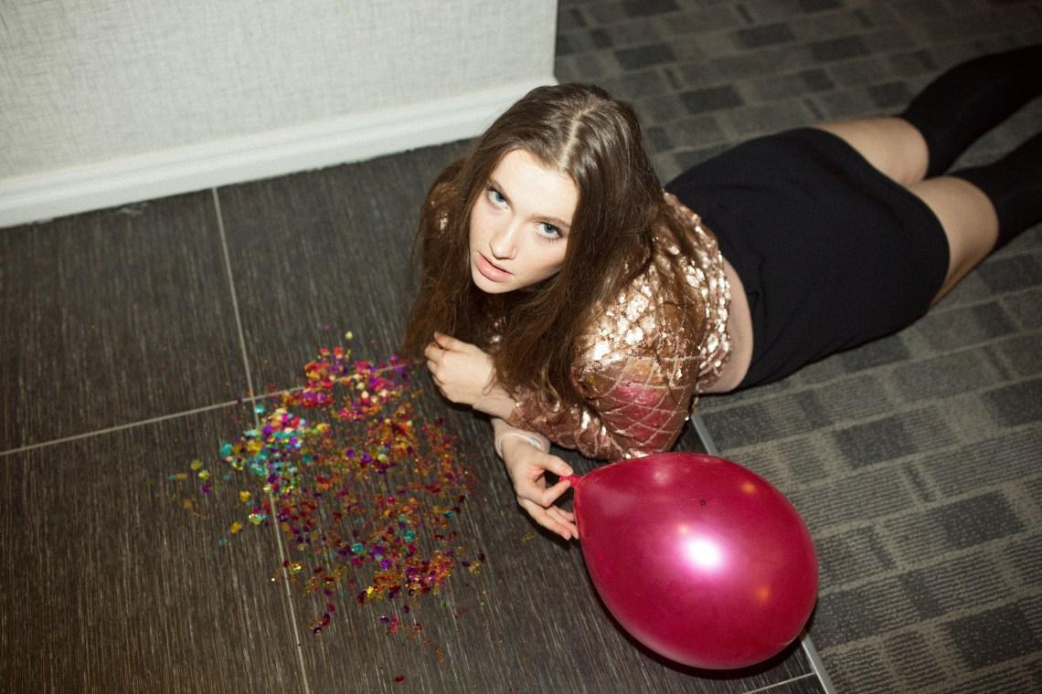 girl laying on ground on NYE