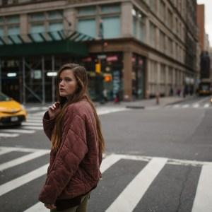 woman sad on crosswalk