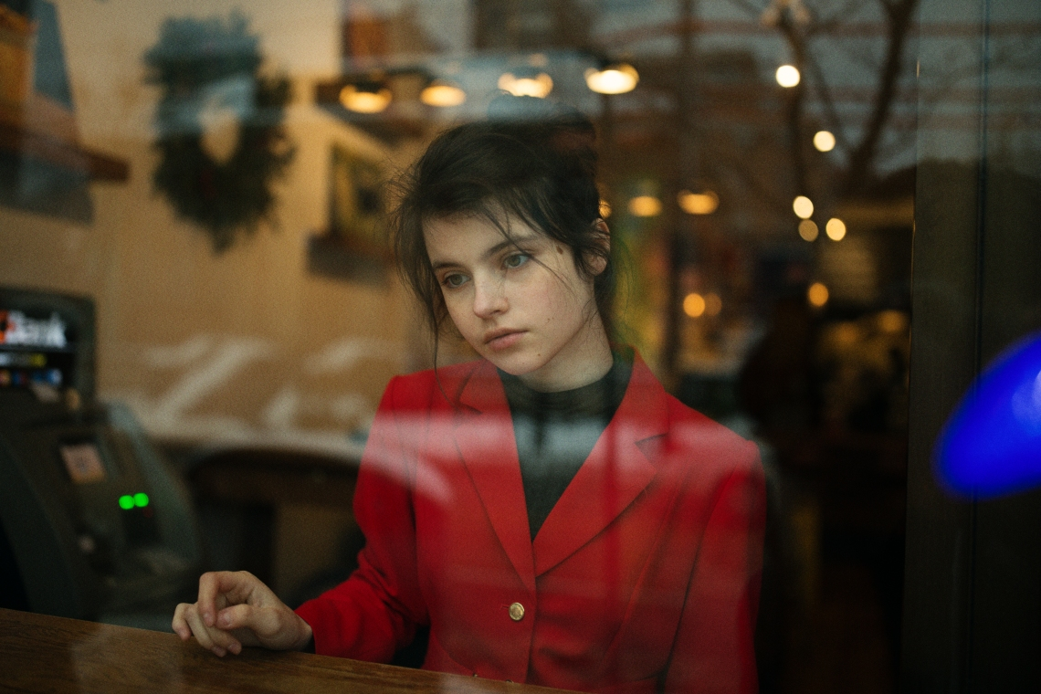 woman deep in thought at cafe