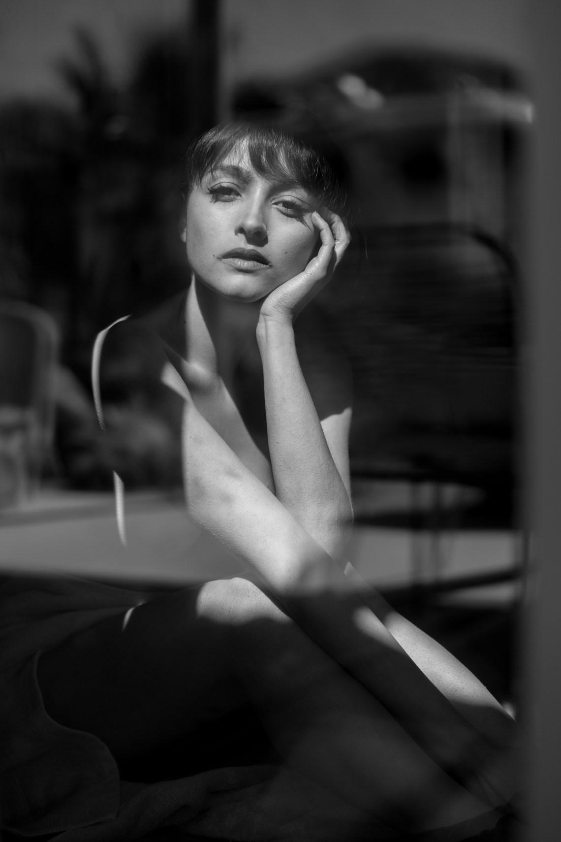 woman sitting looking sad