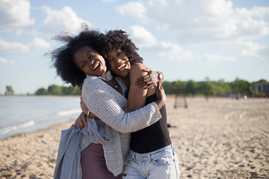 friends hugging it out on the beach