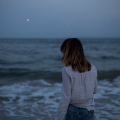 Woman looks out at the ocean