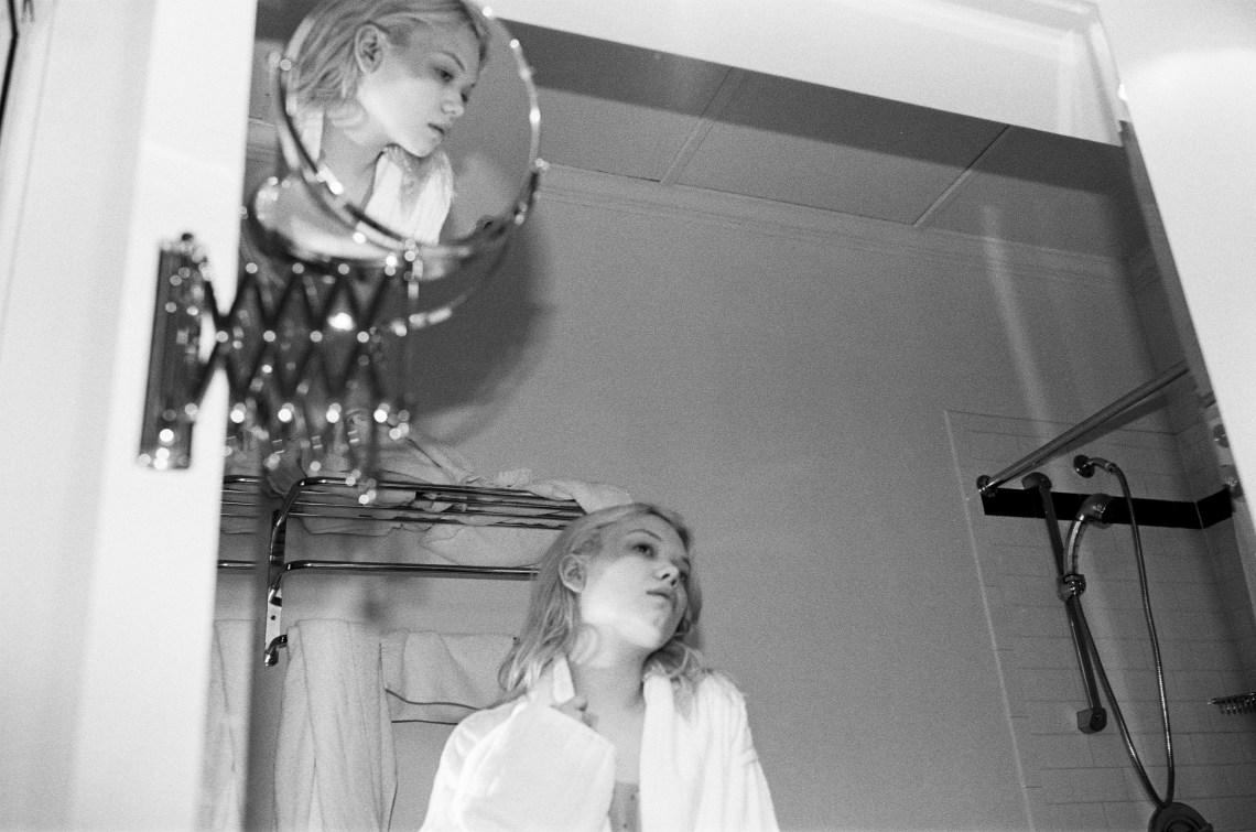 woman looking depressed staring in mirror