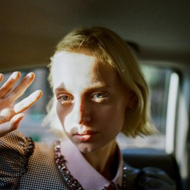 sad girl illuminated by white light