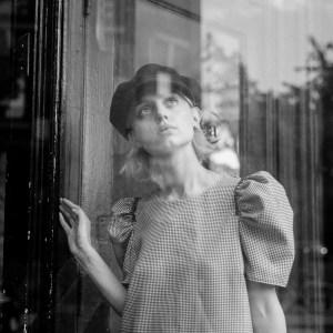 sad girl looking up through window