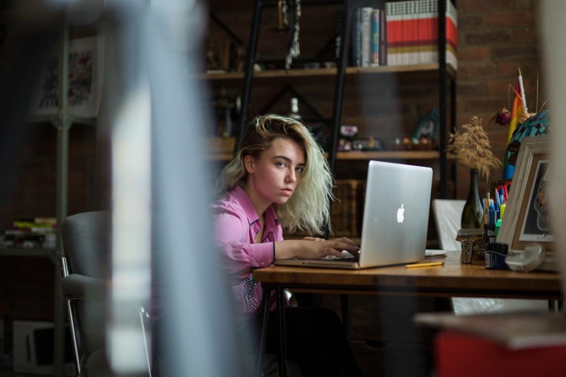 glaring girl on laptop