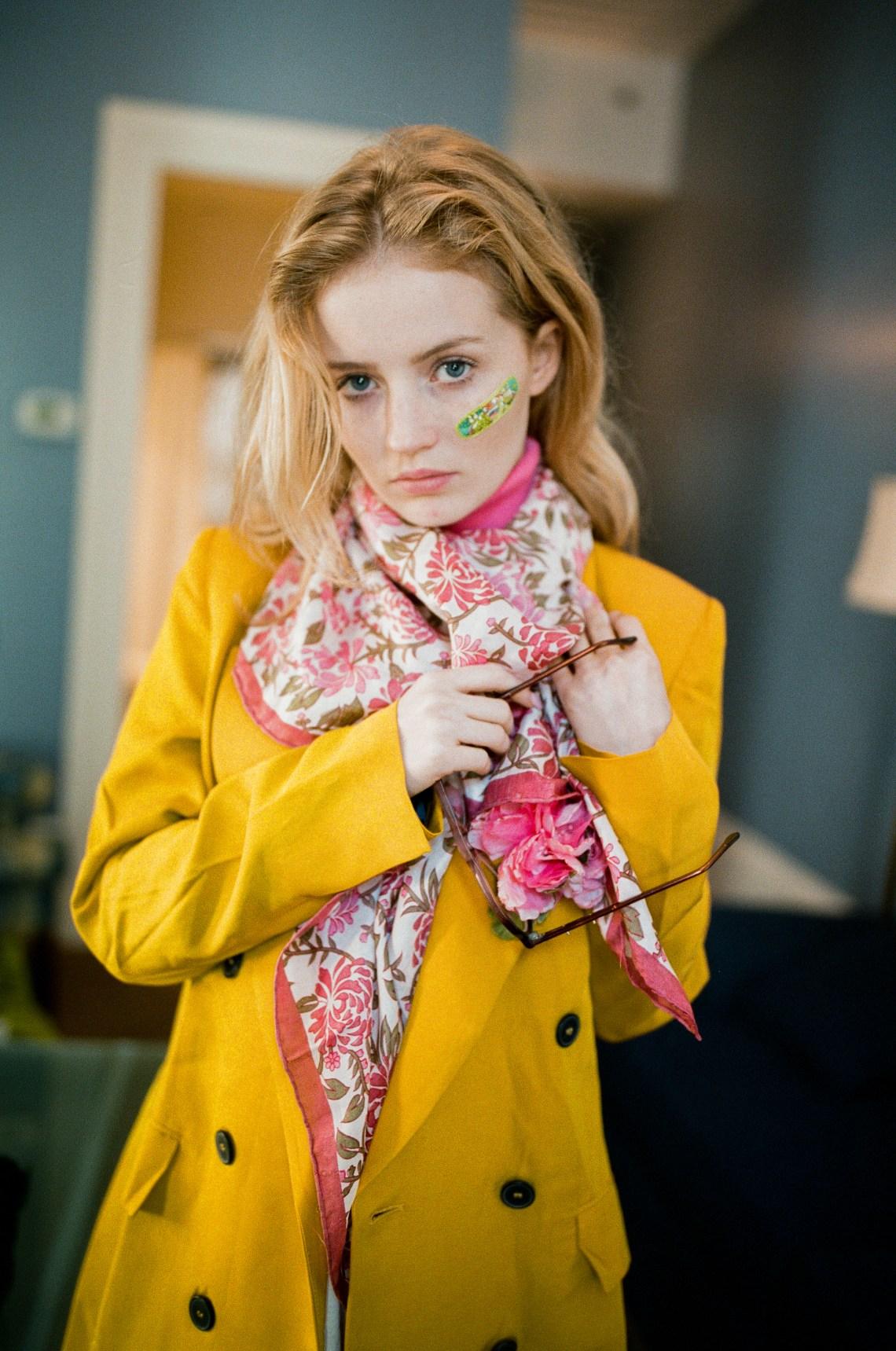 woman adjusting scarf