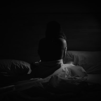 black and white photo of woman in a bed