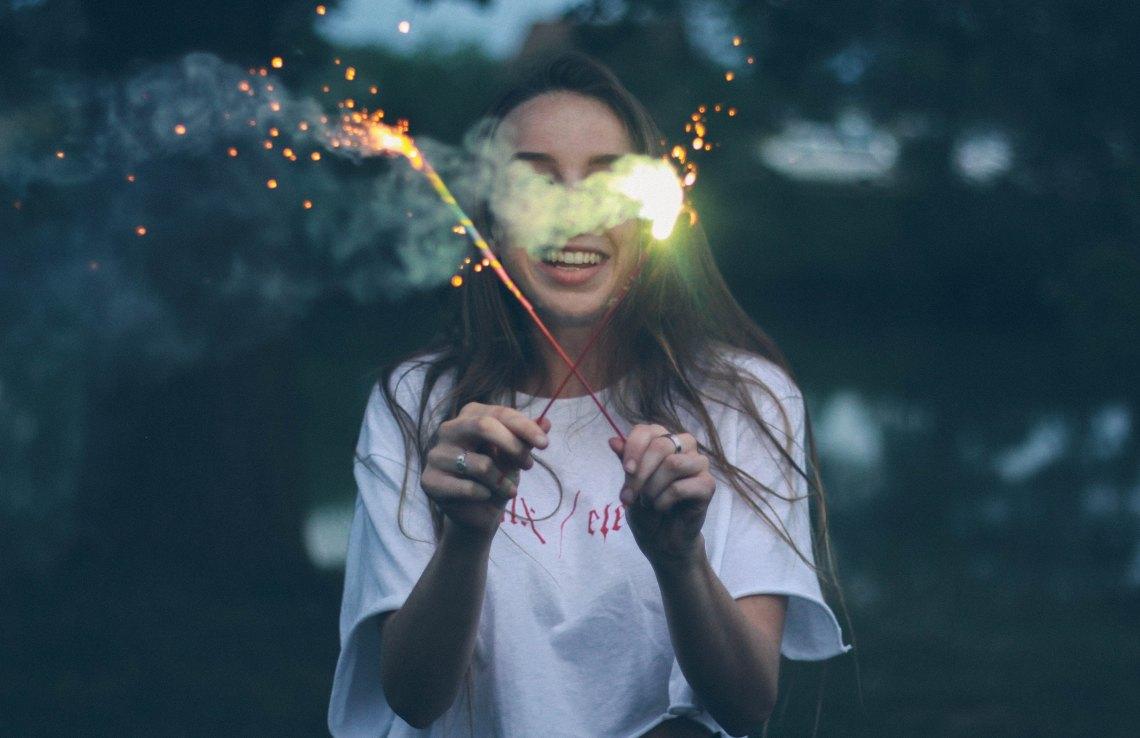 girl holding sparklers