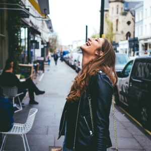 Woman laughing on street
