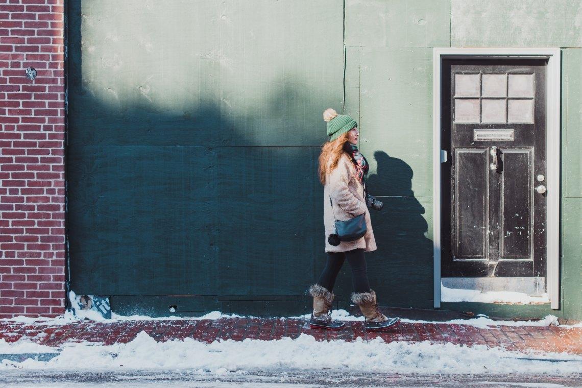 girl walking through the snow
