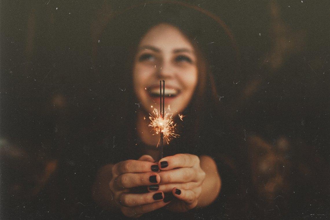 Woman holding up sparkler
