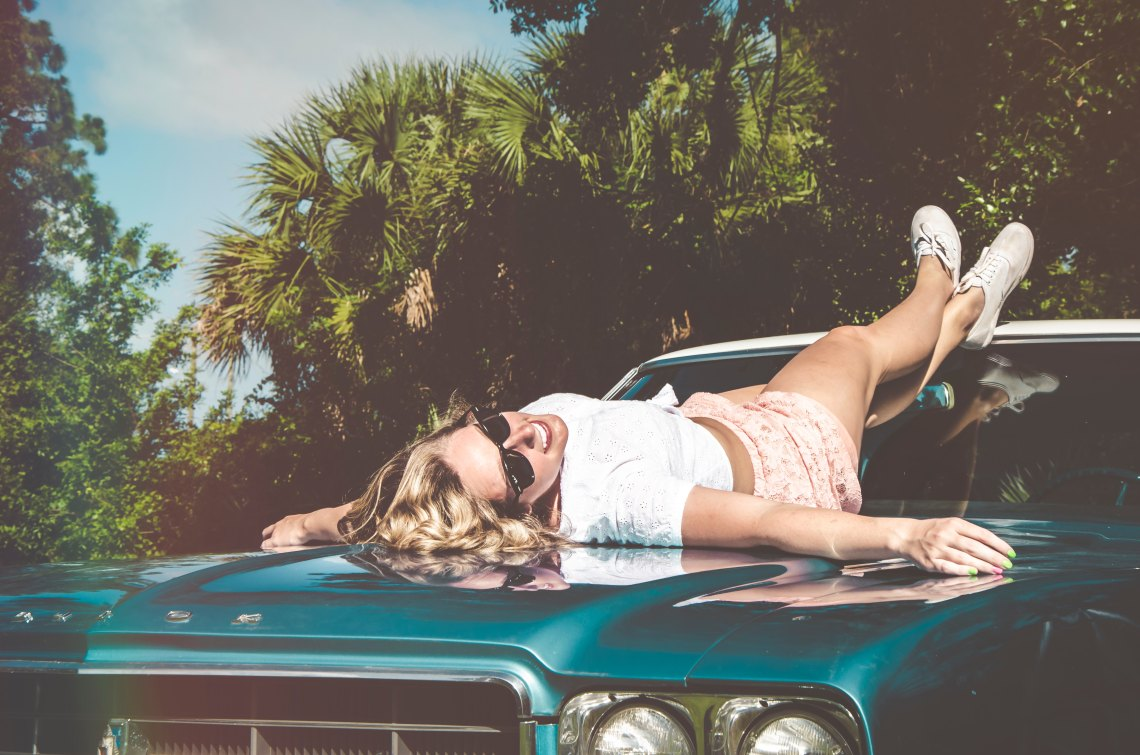 Girl laying on car