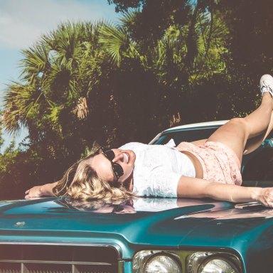 Girl laying on car