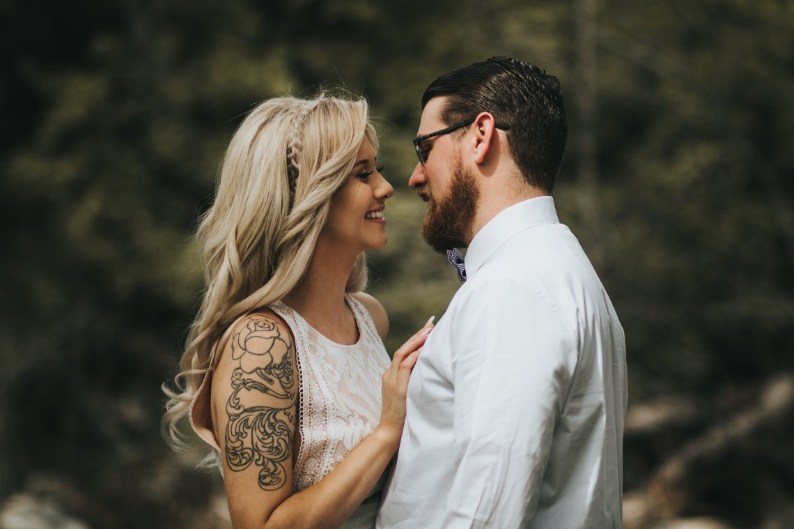couple with tattoos and a cool vibe loving each other