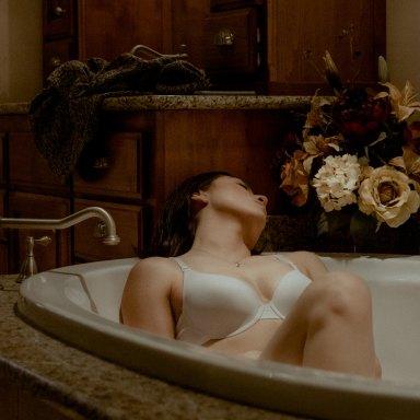 woman sitting in bathtub