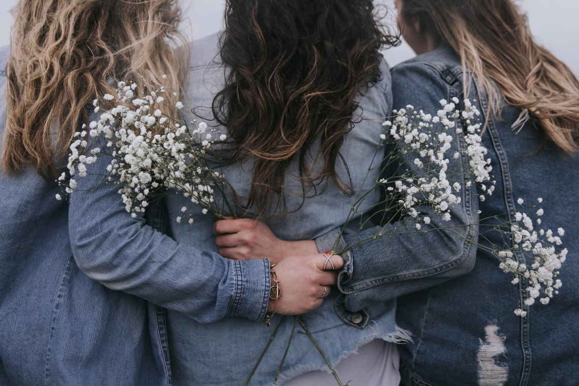 group of girls with flowers in their hands