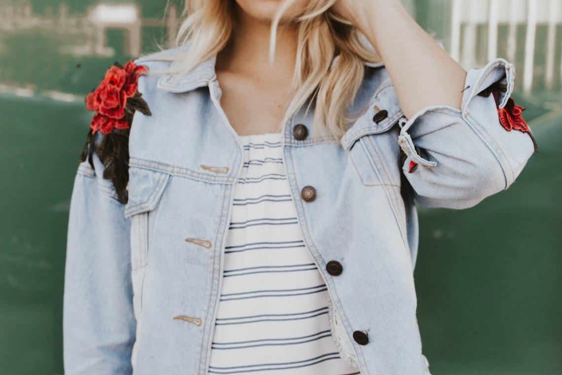 woman standing in jean jacket