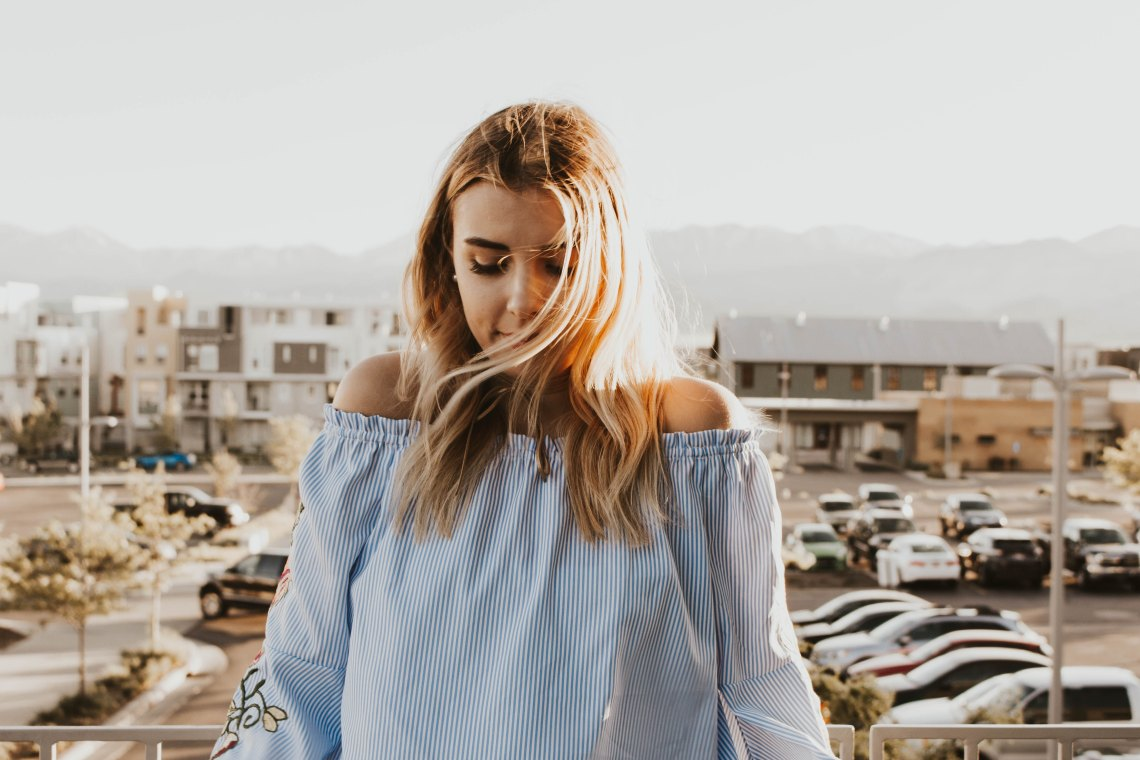 girl standing in sunshine