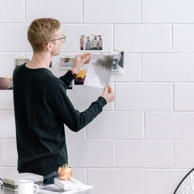guy working on a white wall