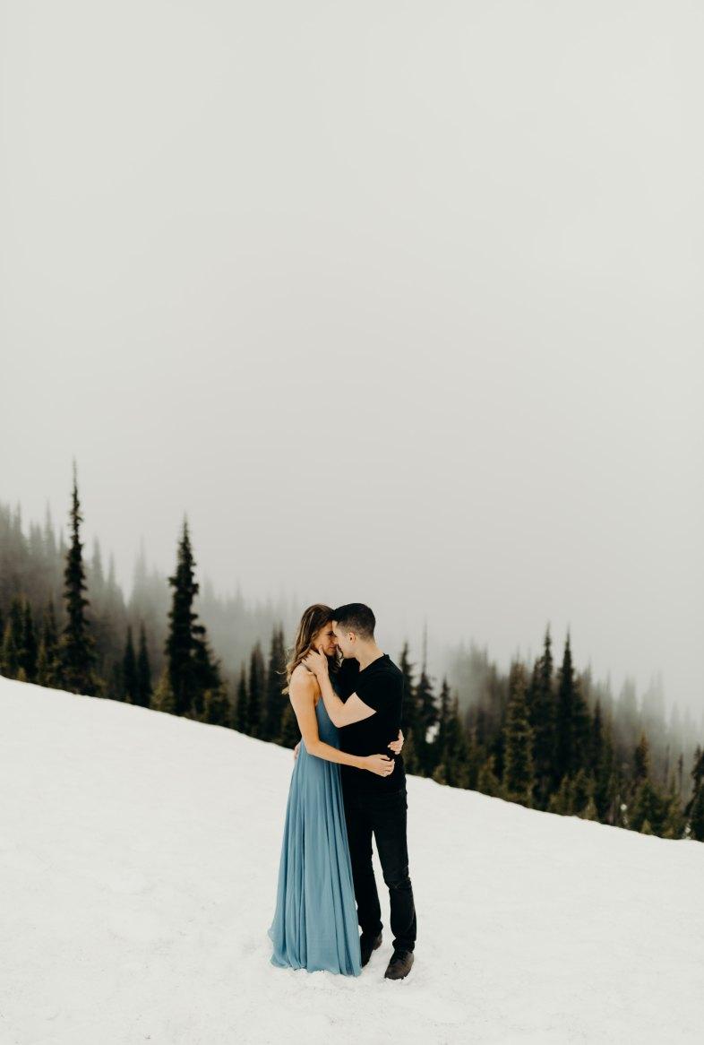 couple on a snowy hill