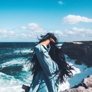 woman by the sea with windy hair