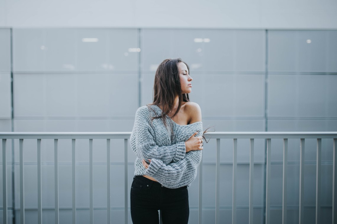 girl in a grey sweater eyes closed