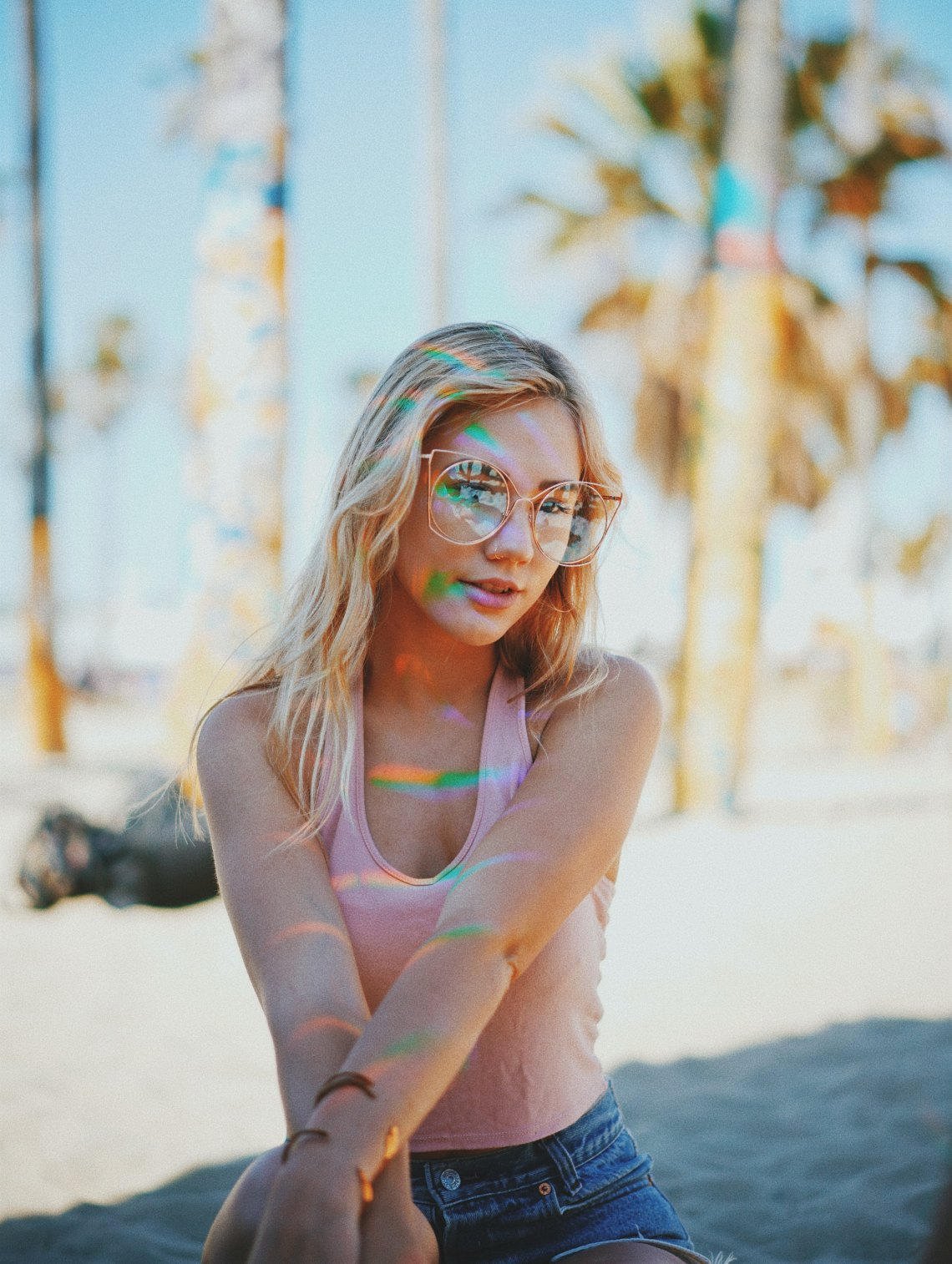girl in glasses with rainbows on her