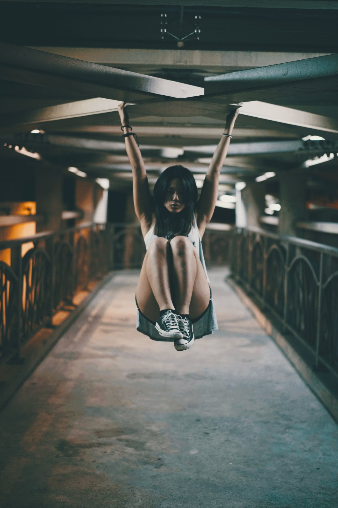 woman hanging with knees up