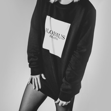 woman in a black sweatshirt