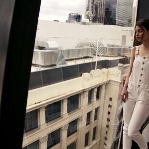 girl in white overalls