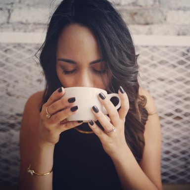 girl drinking coffee black nails