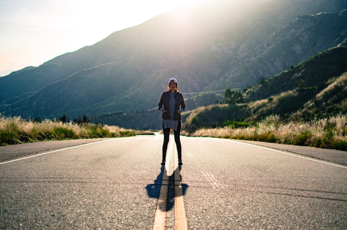 girl standing in road, confident girl, chasing dreams, new year, resolutions, year of pursuit, chase your dreams