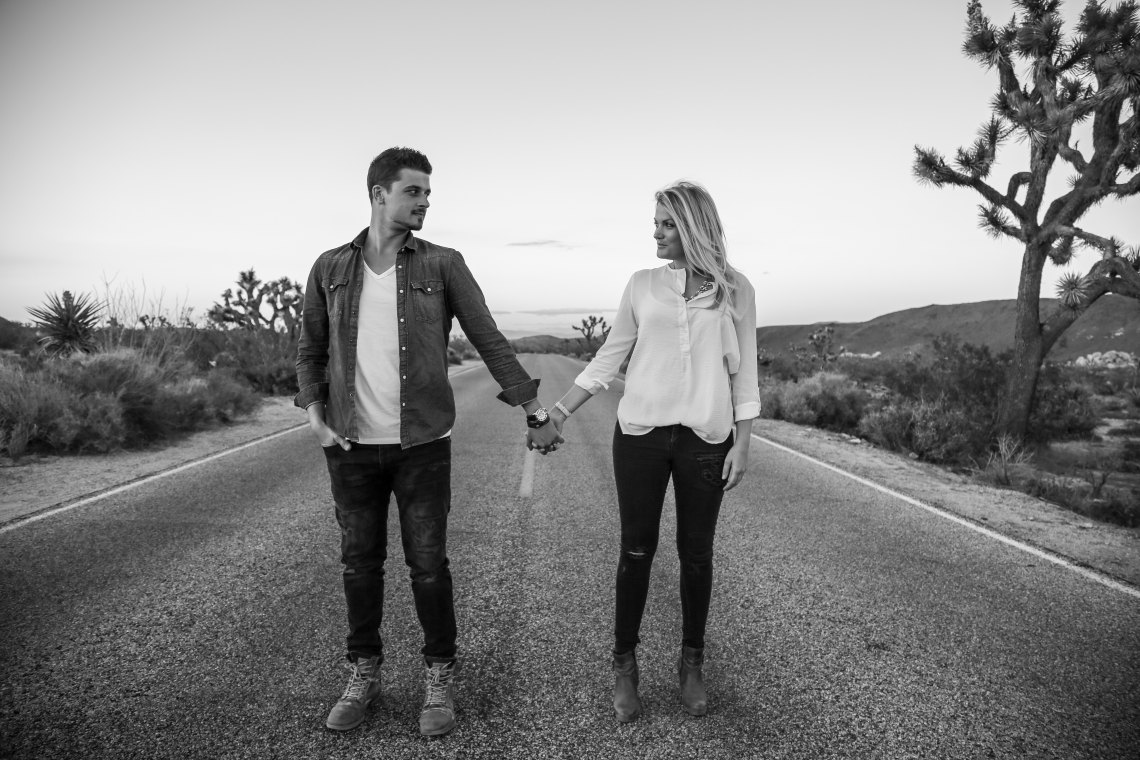 couple holding hands on street