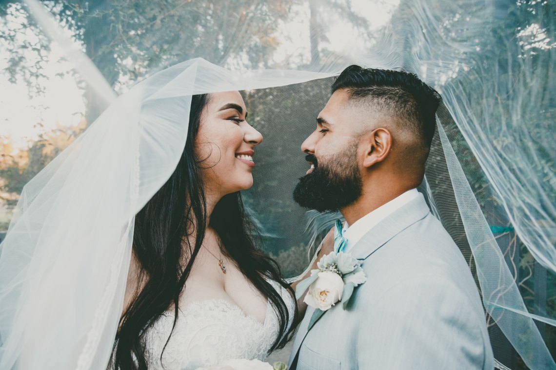 bride and groom looking lovingly at each other
